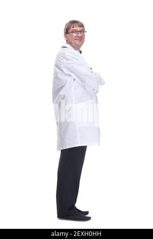 Mature doctor with a stethoscope looking at a white screen.