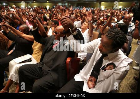 Leslie McSpadden, Jr., right, and his father Leslie McSpadden, Sr. raise their hands in prayer during the funeral for Michael Brown at Friendly Temple Missionary Baptist Church on Monday, Aug. 25, 2014. The men are the brother and father, respectively, of Michael Brown's mother Lesley McSpadden. (Photo by Robert Cohen/St. Louis Post-Dispatch/MCT/Sipa USA)