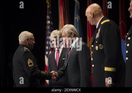 Secretary of Defense Chuck Hagel, second from right, shakes hands with retired U.S. Army Sgt. 1st Class Melvin Morris before presenting him with a Medal of Honor flag during a Hall of Heroes induction ceremony at the Pentagon in Arlington, Va., March 19, 2014. (Photo by Sgt. Aaron Hostutler, U.S. Marine Corps/DoD/Sipa USA)