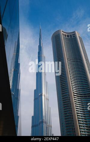 DUBAI, UNITED ARAB EMIRATES - FEBRUARY 10, 2021: Bottom-up view of Burj Khalifa in contrast with the blue sky and clouds. Burj khalifa, the highest bu Stock Photo