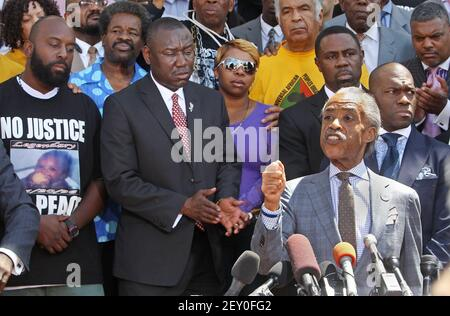 Rev. Al Sharpton addresses the media at a press conference about the shooting of Michael Brown on the steps of the Old Courthouse in St. Louis, Mo., on Tuesday, Aug. 12, 2014. Behind Sharpton, from left, is Michael Brown Sr., attorney Benjamin Crump, and Lesley McSpadden, Brown's mother. (Photo by J.B. Forbes/St. Louis Post-Dispatch/MCT/Sipa USA)