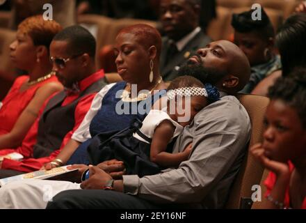 Michael Brown Sr. sits with an unidentified girl on his lap during the funeral services for his son Michael Brown on Monday, Aug. 25, 2014, at Friendly Temple Missionary Baptist Church in St. Louis. Also pictured are, from left: Lesley McSpadden, Michael Brown's mother; Louis Head, Michael Brown's stepfather; and Cal Brown, Michael Brown's stepmother. (Photo by Robert Cohen/St. Louis Post-Dispatch/MCT/Sipa USA)