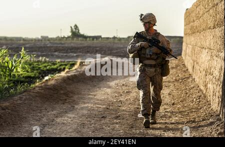 U.S. Marine Corps Lt. Col. Bradley Weston, a battalion commander with the 1st Battalion, 2nd Marine Regiment, observes surrounding compounds during a security patrol in Helmand province, Afghanistan, Oct. 7, 2014. (Photo by Cpl. John A. Martinez Jr., U.S. Marine Corps/DoD/Sipa USA)