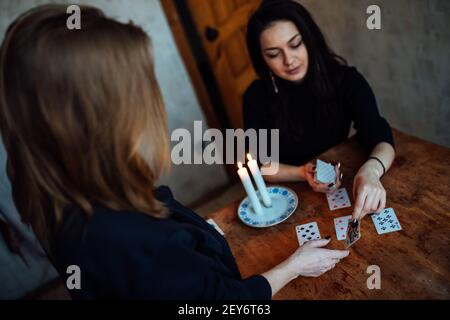 choose a card from the hands of a fortune teller. a woman tells fortunes during a magical ritual. belief in mysticism