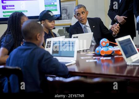 U.S. President Barack Obama talks to middle-school students who are participating in an ÒHour of CodeÓ event in the Eisenhower Executive Office Building next to the White House in Washington, D.C., U.S., on Monday, Dec. 8, 2014. The event is in honor of Computer Science Education Week. (Photographer Andrew Harrer/ISP/Sipa USA)