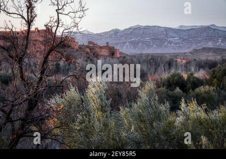 small local village in Morocco near mountains and bushes - Stock Photo