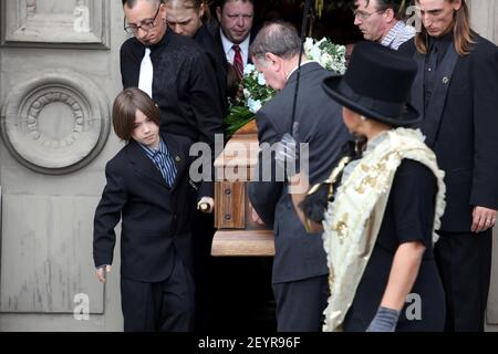 3 February 2012 - New Orleans, Louisiana - Funeral mass for local hero Harry 'Mike' Ainsworth. Ainsworth's youngest son Dameon (9 yrs) leads the pall bearers carrying his father's coffin at Saint Louis Cathedral during the funeral mass remembering Ainsworth, who was shot and killed in front of his boys as he attempted to thwart a carjacking in in Algiers Point. Photo Credit: Charlie Varley/Sipa USA