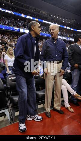 16 July 2012 - Washington, D.C. - US President Barack Obama and Vice President Joe Biden attend the Olypmics-bound U.S. men's national basketball team game against Brazil, at the Verizon Center on Monday, July 16, 2012, in Washington, DC. Photo Credit: Leslie E. Kossoff/Pool/Sipa USA