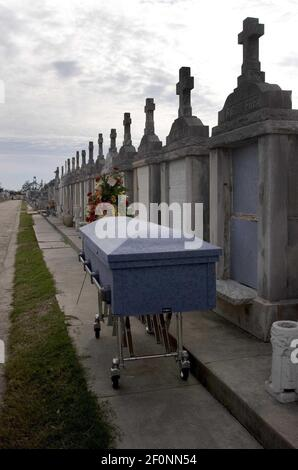 9 December 2005 - New Orleans, LA - Aftermath of Hurricane Katrina, New Orleans, Louisiana. 3 1/2 months after the storm, New Orleans continues to bury the victims. The coffin of Vincent Giuffre at Greenwood cemetery. 87 year old Guiffre died in the arms of his 77 yr old wife Geneva in New Orleans East as the flood waters swirled aroud their kitchen on August 29th, 2005. Photo Credit: Charley varley/Sipa press/0512160021 Stock Photo