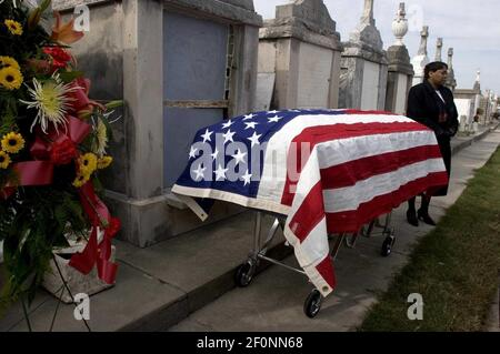9 December 2005 - New Orleans, LA - Aftermath of Hurricane Katrina, New Orleans, Louisiana. 3 1/2 months after the storm, New Orleans continues to bury the victims. An undertaker stands beside the coffin of Vincent Giuffre at Greenwood cemetery. 87 year old Guiffre died in the arms of his 77 yr old wife Geneva in New Orleans East as the flood waters swirled aroud their kitchen on August 29th, 2005. Photo Credit: Charley varley/Sipa press/0512160020 Stock Photo