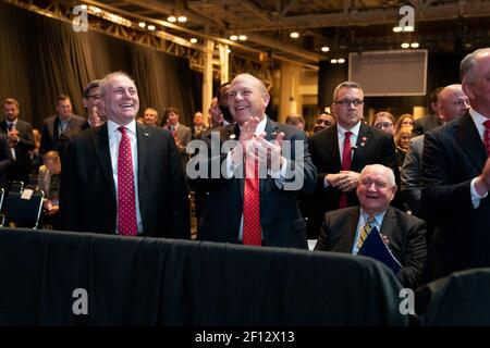 House Minority Whip Rep. Steve Scalise (R-LA) Zippy Duvall the President of the American Farm Bureau Federation and Secretary of Agriculture Sonny Perdue share a laugh with President Donald Trump during his remarks at the American Farm Bureau Federation's 100th Annual Convention Monday January 14 2019 at the New Orleans Ernest N. Morial Convention Center in New Orleans Louisiana.