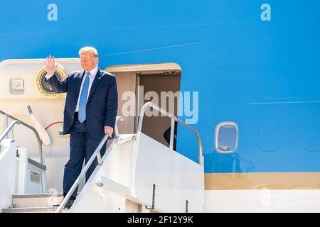 President Donald Trump waves as he disembarks Air Force One at Marine Corps Air Station Miramar Wednesday Sept. 18 2019 in San Diego Calif.