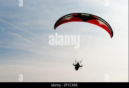One Man Rides Flies Ultralight Flying Through Blue Sky Stock Photo