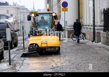 A street cleaning machine clearing snow from the streets  in  Helsinki, Finland - Stock Photo