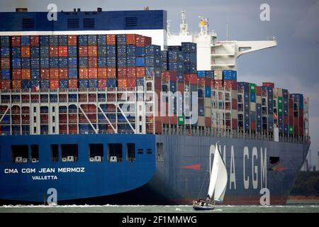 Container,Ship,large,huge,big,massive,small,boat,boating,yacht,maneuvering,The Solent,Port,Southampton,Cowes,Isle of Wight,England,UK,