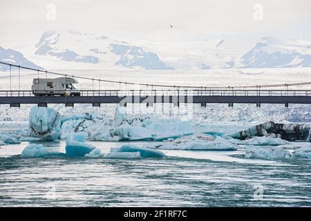 RV driving on suspension bridge over the glacier lagoon Jökulsárlón