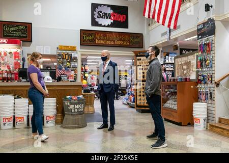 Washington, United States Of America. 09th Mar, 2021. U.S President Joe Biden visits with Mary Anna Ackley, Owner of Little Wild Things Farm, left, and Michael Siegel, Co-owner of W.S. Jenks & Son, right, during a visit at W.S. Jenks & Son hardware store, a small business that received a Paycheck Protection Program loan, March 9, 2021, in Washington. Credit: Planetpix/Alamy Live News