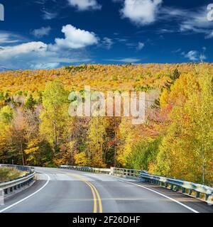 Highway at autumn day, Maine, USA.