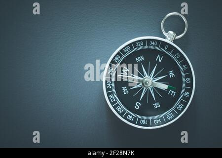 Compass lying on a blue office desk. Concept for business and creativity