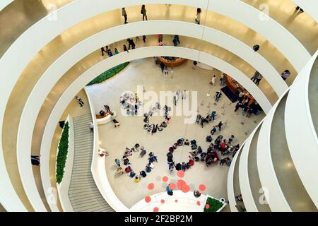 Visitors and schoolchildren, interior of Solomon R. Guggenheim Museum, Manhattan, New York City, USA, North America