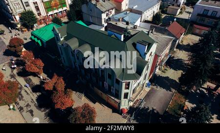 Aerial view of the new green tiled roof with a weather vane. View from above. - Stock Photo