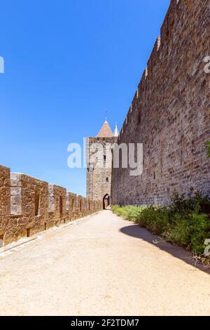 Wide fortified walls with walkways and arches of medieval castle of Carcassonne town