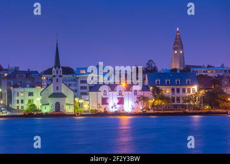 Night view of the free lutheran church and Hallgrimskirkja cathedral in Reykjavik, Iceland