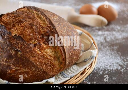 Freshly baked homemade sourdough bread with a crisp crust close-up, selective focus.