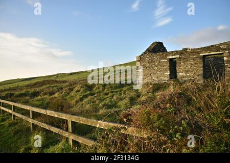 Irish landscape with an abandoned stone house in the countryside of Doolin in County Clare, Ireland.