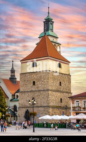 Zywiec, Poland - August 30, 2020: Panoramic view of market square with historic stone bell tower and Cathedral of Nativity of Blessed Virgin Mary