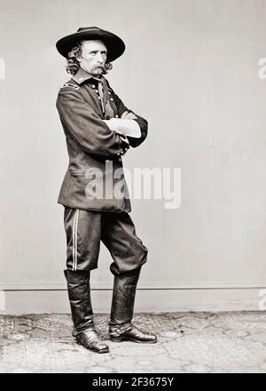 George Armstrong Custer, 1839 – 1876.  United States Army officer and cavalry commander in the American Civil War and the American Indian Wars who was killed along with most of his command at the Battle of the Little Bighorn.  After a photograph dating from 1865.