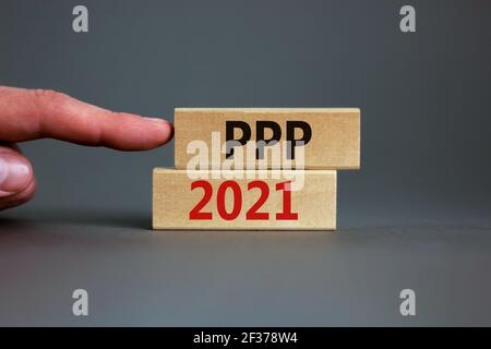 PPP, paycheck protection program 2021 symbol. Concept words PPP, paycheck protection program 2021 on wooden blocks on a beautiful grey backgrounds. Bu