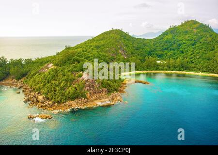 Aerial sunset landscape of the tropical Mahe Island and beautiful lagoons, Seychelles