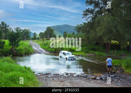 Four wheel drive vehicle crossing the Condamine River at Killarney, a popular spot for off-road driving, Queensland, QLD, Australia