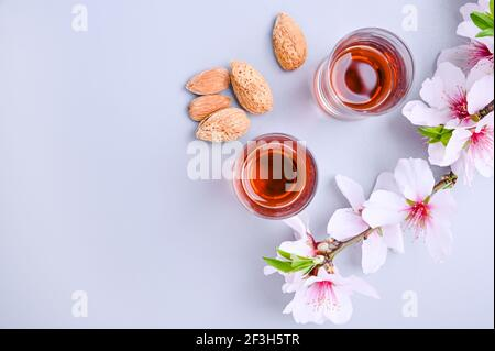 almond liquor. The traditional strong drink in italy to complete the dinner is a liqueur made from nuts and berries. Ratafia, alcohol in shot. top view on the table. Copy space