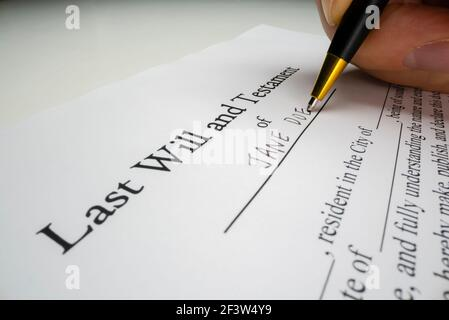 Close-up view of writing a last will Stock Photo