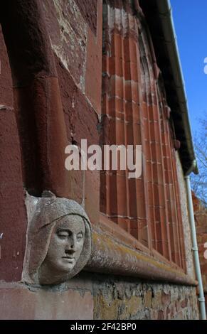 Female gargoyle head on side of St Marys Church Acton Burnell, Shropshire