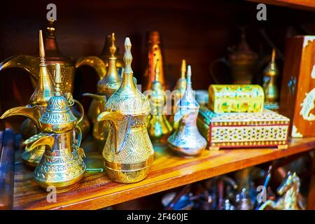 The dallah coffee pots, covered with intricate carved patterns in stall of Al Souk al Kabir (Old Market) in Dubai, UAE