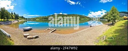 Idyllic Bajer mountain lake and highway A6 viaduct panoramic view, Fuzine in Gorski Kotar region of Croatia - Stock Photo