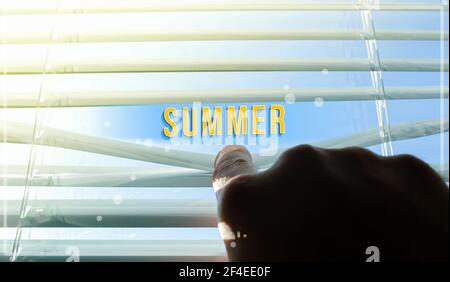The sun shines through the half-open blinds on the window. Blinds ajar by hand. Summer inscription on the background of the sun. Summer is visible thr - Stock Photo