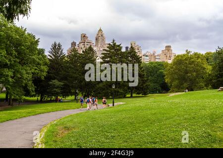 Tourists with backpacks walking on a trail in Central Park