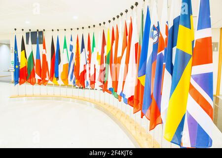 Brussels, Belgium. Row of flags of participating member nations inside the European Parliament.