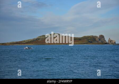 Landscape with scenic view of Ireland's Eye island as seen from the Port of Howth in County Leinster Dublin Ireland.