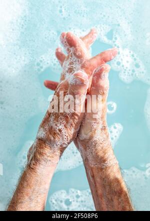 Close up senior woman washing hands in soapy water