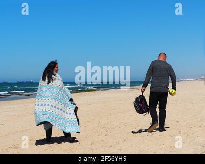Nitzanim beach, Israel - 6 March, 2021: Family couple on the beach.