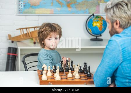 Games and activities for children. Family concept. Kids early development. Boy think or plan about chess game, vintage style for education concept.