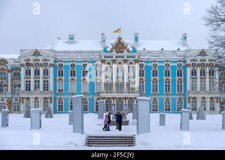 Tsarskoye Selo, Saint-Petersburg, Russia – February 16, 2021: Family with children walk in the Catherine Park near the Catherine Palace in winter