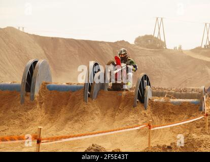 Motorbike enduro races. The competitor overcomes the obstacle along the route. - Stock Photo