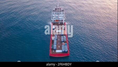Offshore Supply Ship in the calm ocean water.
