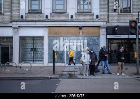 Empty shops on Wimbledon High Street due to the effect on the retail industry from the Coronavirus Lockdown during the pandemic in 2020/21, London, UK - Stock Photo